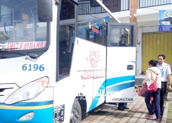 Nusabali.com - angkutan-damri-khusus-siswa-tetap-beroperasi
