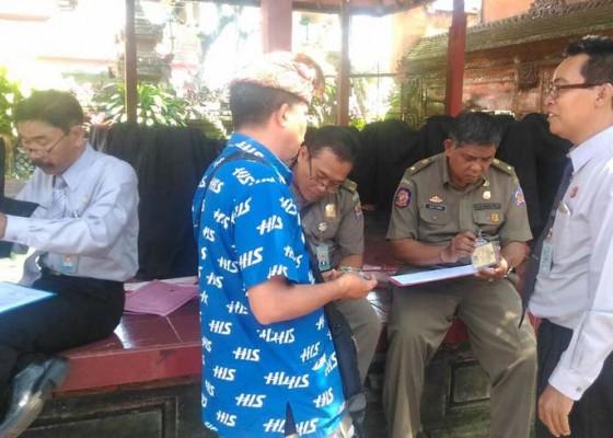 Nusabali.com - petugas-tertibkan-8-guide-ilegal