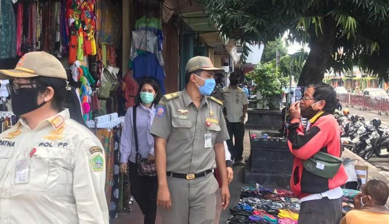 www.nusabali.com-pengunjung-pasar-tak-bermasker-dipulangkan
