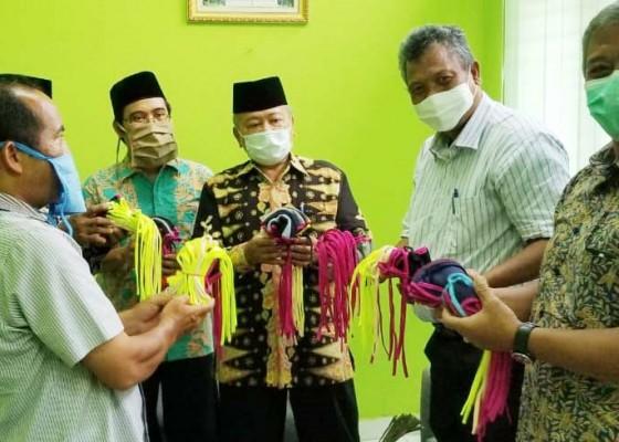 Nusabali.com - phdi-banten-bantu-masker-ke-mui