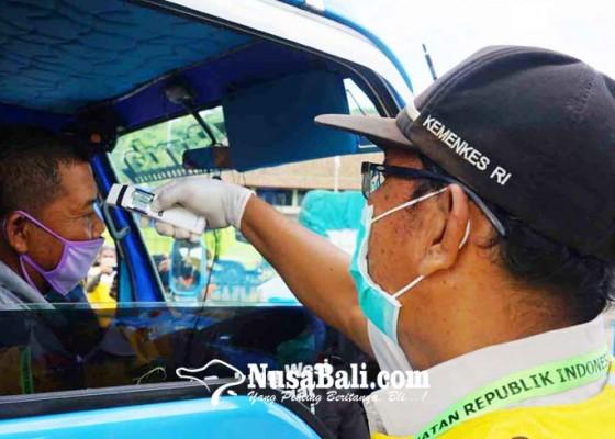 Nusabali.com - suhu-tubuh-tinggi-belasan-sopir-truk-dicekal