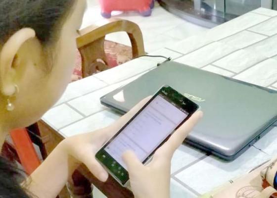 Nusabali.com - sejumlah-smp-di-tabanan-gelar-uas-online-siswa-dibantu-pulsa