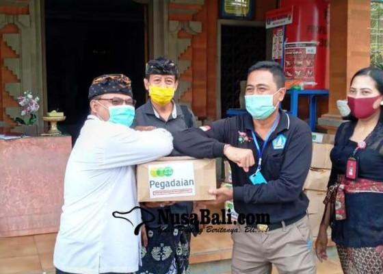 Nusabali.com - pegadaian-salurkan-sembako