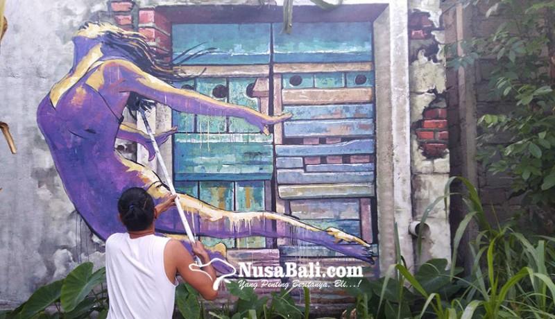 www.nusabali.com-aksi-seniman-mural-merespons-pandemi