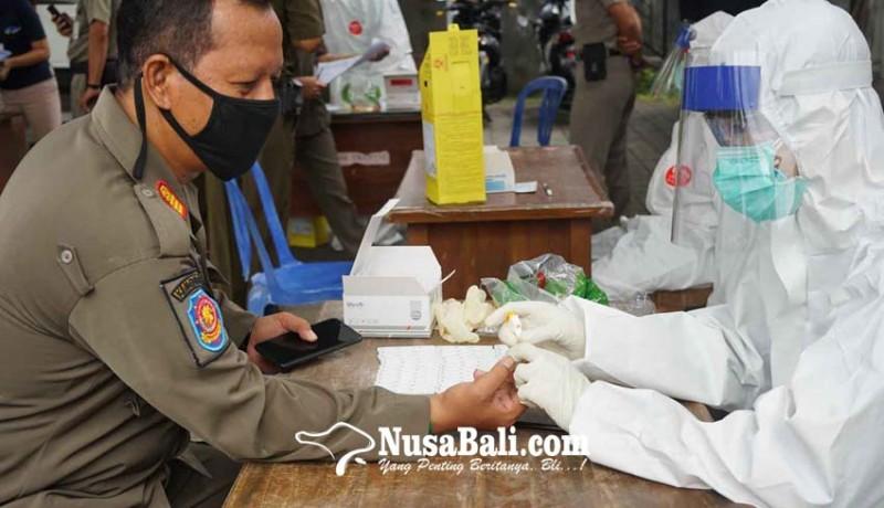 www.nusabali.com-satu-satpol-pp-reaktif