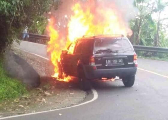 Nusabali.com - baru-diperbaiki-ford-escape-malah-terbakar-di-gitgit