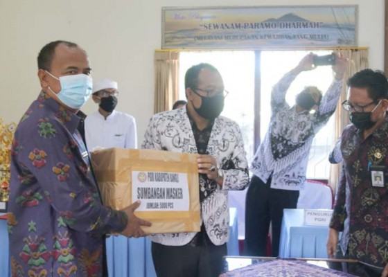 Nusabali.com - pgri-bagikan-masker-dan-vitamin