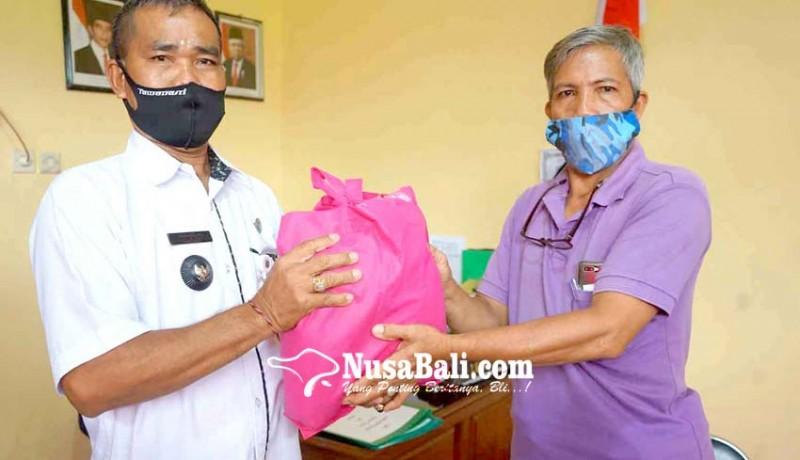 www.nusabali.com-dua-lurah-alihkan-bantuan-bahan-pokok