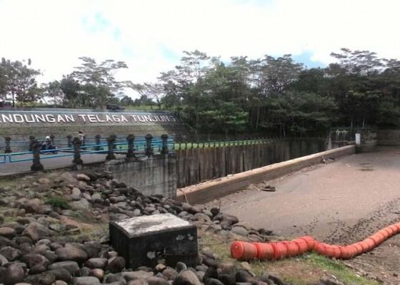 Nusabali.com - air-bendungan-telaga-tunjung-surut