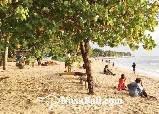 Nusabali.com - pantai-kuta-belum-dibuka-wisatawan-lewat-jalur-tikus