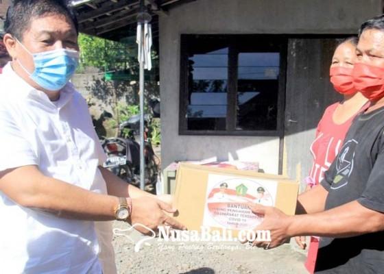 Nusabali.com - 1182-kk-di-kecamatan-jembrana-terima-sembako-jps-tahap-ii