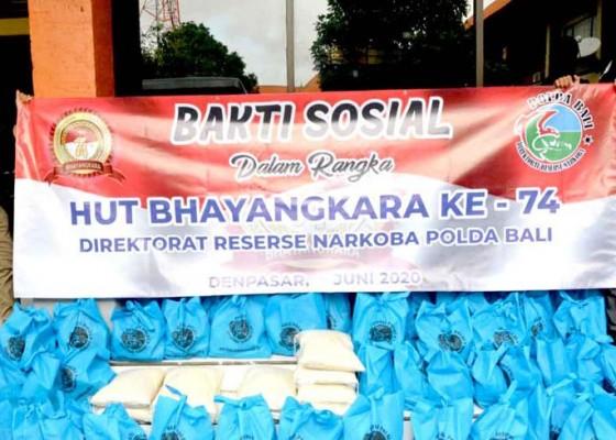 Nusabali.com - dit-narkoba-polda-bali-bagi-bagi-300-paket-sembako