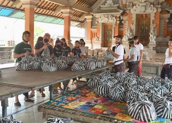 Nusabali.com - stt-di-desa-mas-bagikan-394-sembako-ke-krama