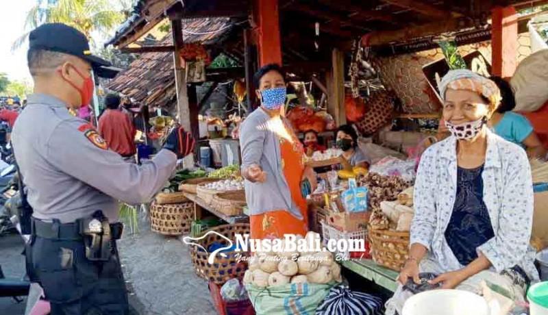 www.nusabali.com-polsek-kubu-bagikan-100-masker