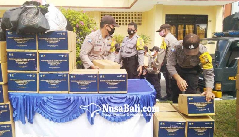 www.nusabali.com-polres-buleleng-distribusikan-bantuan-kemenparekraf