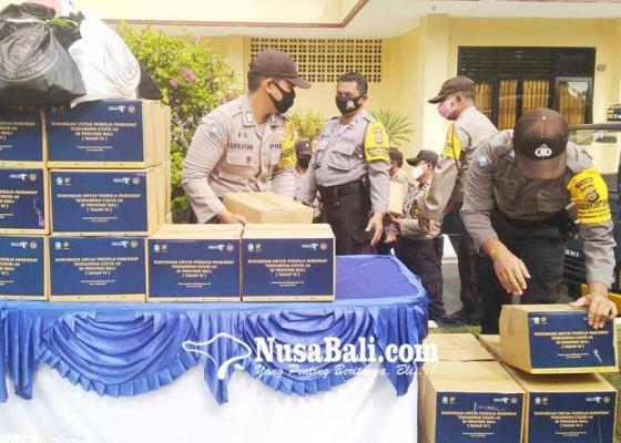 Nusabali.com - polres-buleleng-distribusikan-bantuan-kemenparekraf