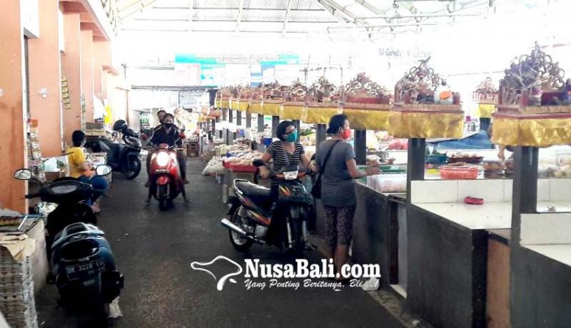 www.nusabali.com-pasar-desa-adat-padangsambian-tetap-buka