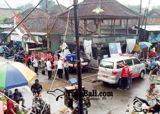 Nusabali.com - pedagang-pasar-rakyat-ulakan-wajib-pakai-face-shield