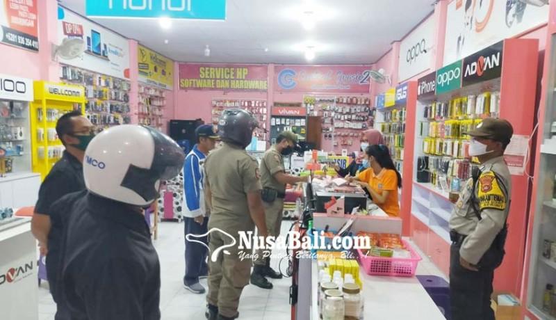 www.nusabali.com-langgar-jam-buka-tutup-pedagang-pasar-seririt-marah-marah