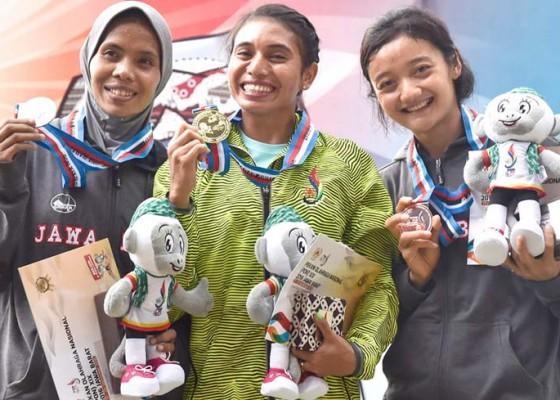 Nusabali.com - maria-londa-pertahankan-medali-emas-lompat-jauh