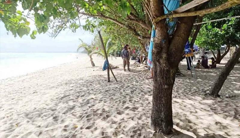 www.nusabali.com-hari-pertama-dibuka-pantai-kuta-masih-sepi