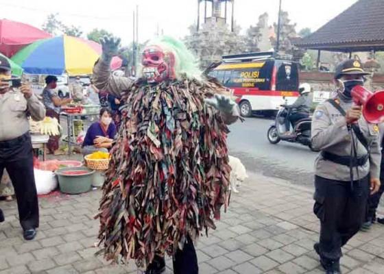 Nusabali.com - celuluk-corona-polres-badung-sosialisasikan-bali-era-baru