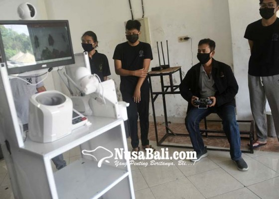 Nusabali.com - universitas-udayana-uji-coba-robot-covid-19