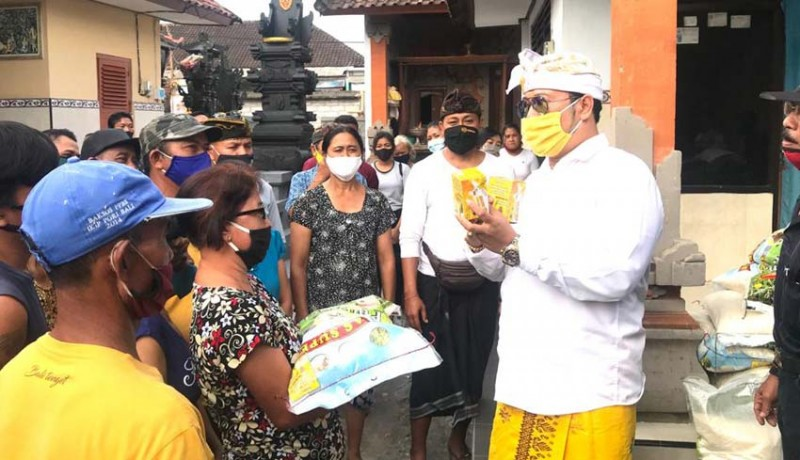 www.nusabali.com-amd-gelontor-sembako-dan-madu-di-peguyangan