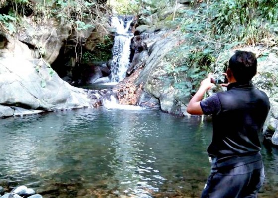 Nusabali.com - desa-padangan-kembangkan-2-air-terjun-yang-bisa-dijadikan-tempat-bersemedi