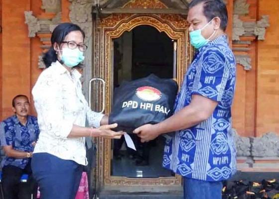 Nusabali.com - dpd-hpi-bali-bagikan-sembako-untuk-600-anggota