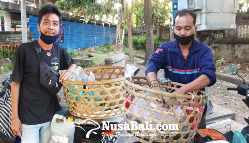 www.nusabali.com-berjualan-di-dekat-lapangan-renon-pedagang-bermotor-tetap-sepi-pembeli