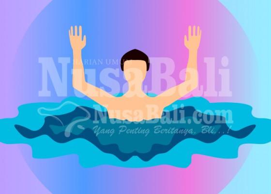 Nusabali.com - mandi-di-laut-kakak-adik-terseret-arus