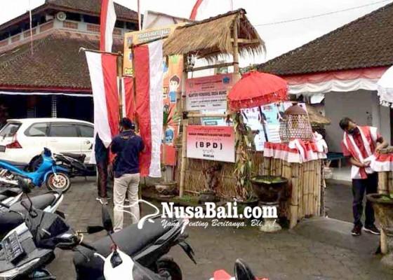 Nusabali.com - semarakkan-hut-ri-perbekel-pasang-atribut-merah-putih