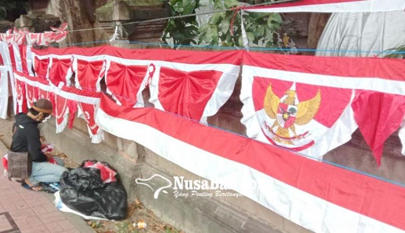 www.nusabali.com-penjualan-bendera-terimbas-covid-19