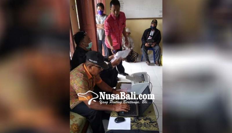 www.nusabali.com-petugas-bkpad-datangi-wajib-pajak