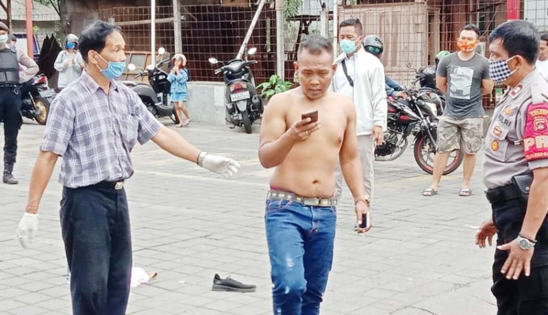 www.nusabali.com-kena-phk-seorang-pria-nekat-coba-bunuh-diri