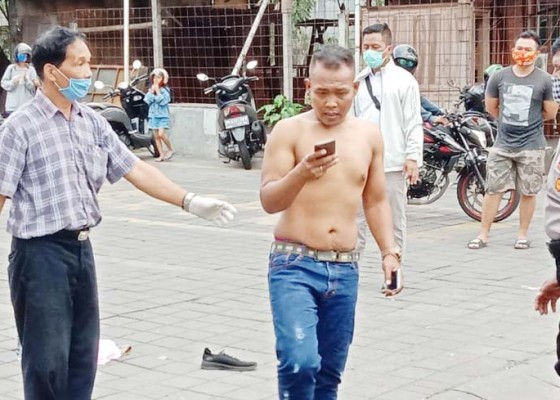 Nusabali.com - kena-phk-seorang-pria-nekat-coba-bunuh-diri