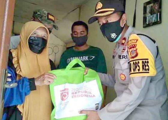 Nusabali.com - polres-karangasem-bagikan-200-kilogram-beras