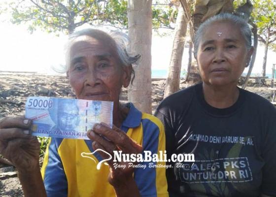 Nusabali.com - terlalu-dadong-dagang-buah-ditipu-pakai-uang-mainan