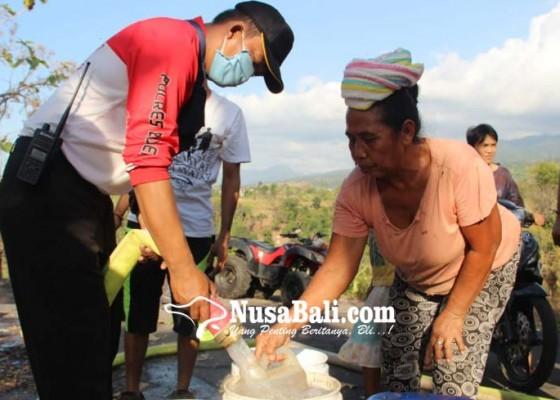 Nusabali.com - polres-buleleng-suplai-air-bersih-di-desa-kayu-putih