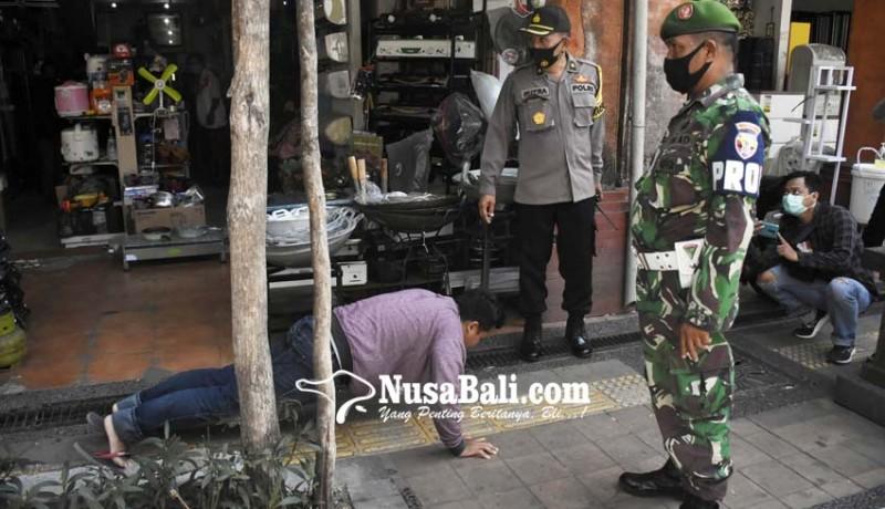 www.nusabali.com-tim-yustisi-denda-17-pelanggar