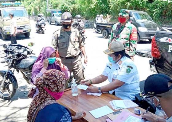Nusabali.com - tanpa-masker-1-warga-didenda-dan-11-pedagang-diamankan