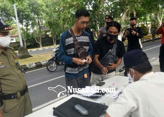 Nusabali.com - 557-orang-terjaring-razia-gabungan-prokes-covid-19