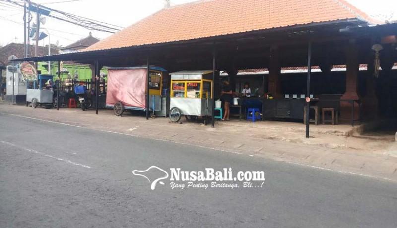 www.nusabali.com-pedagang-kembali-berjualan-di-pasar-desa-adat-penarungan