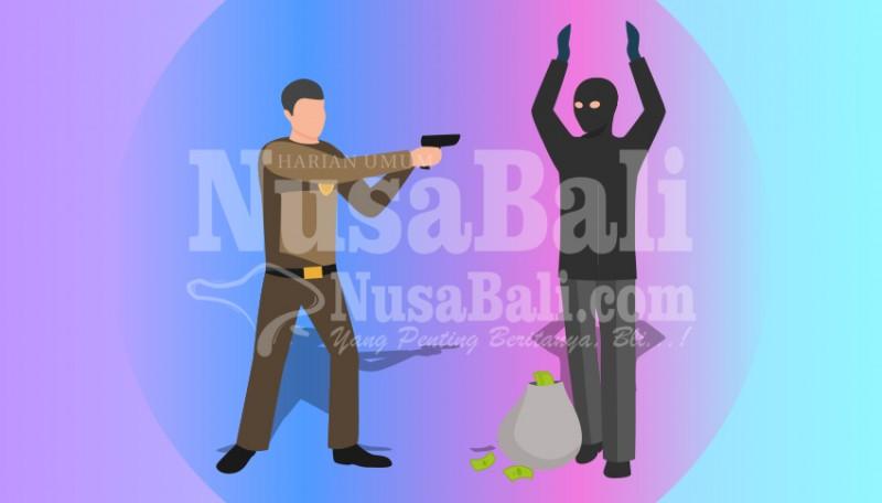 www.nusabali.com-maling-hp-spesialis-kos-kosan-diringkus
