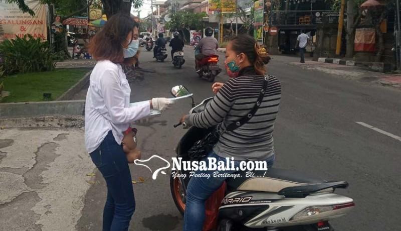 www.nusabali.com-hari-anti-kekerasan-internasional-pik-m-stiki-bagikan-masker-dan-stiker