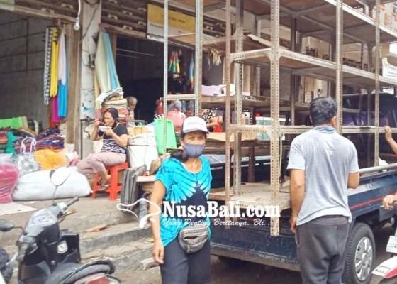Nusabali.com - pedagang-pasar-umum-sukawati-berkemas