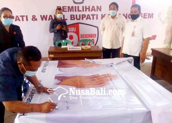 Nusabali.com - tim-massker-tandatangani-dummy-baliho-dan-spanduk