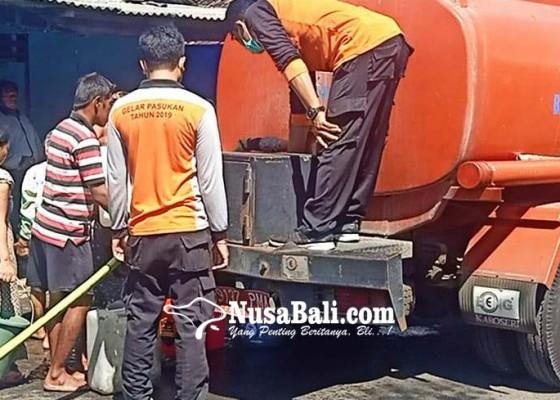 Nusabali.com - sumur-tercemar-bpbd-distribusikan-air-bersih