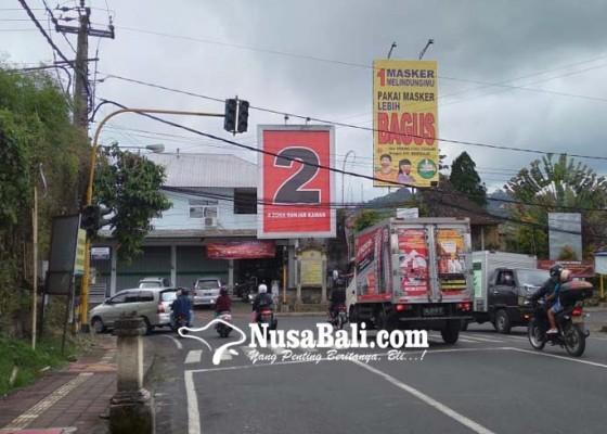 Nusabali.com - bawaslu-bangli-soroti-baliho-mirip-apk-di-papan-reklame